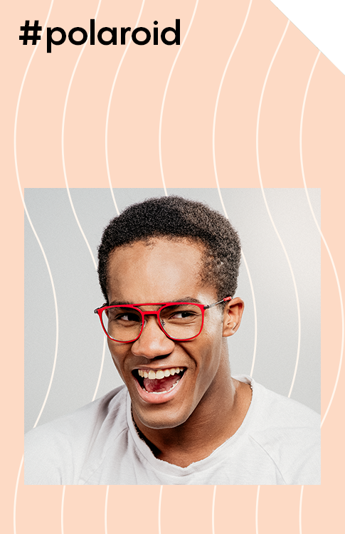 Dominic wears bright, fun, and funky Polaroid eyeglasses